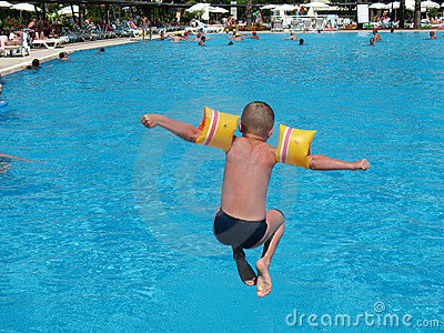 Boy jumping in swimming pool