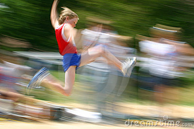 Boy jumping at track meet /motion blur