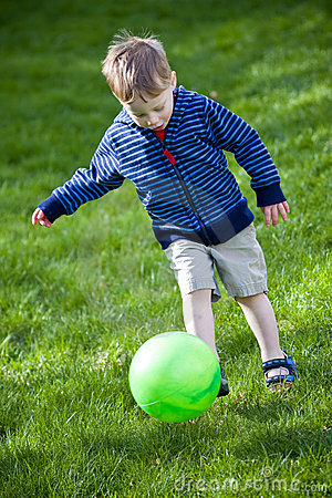 Boy Kicking Ball Royalty Free Stock Images