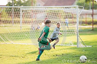 Boy kicking a ball