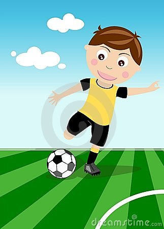 Boy kicks a soccer ball