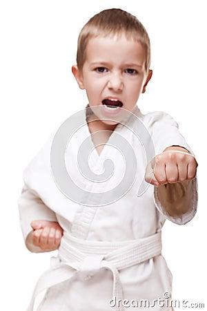 Boy in kimono training karate