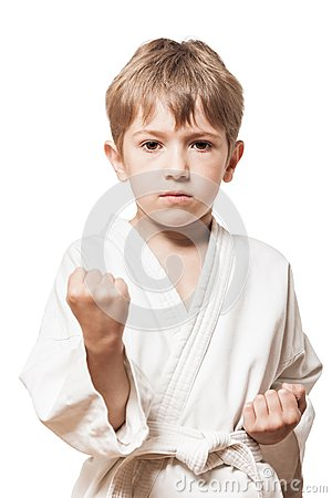 Boy in kimono training karate