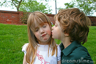 A boy kissing a girl
