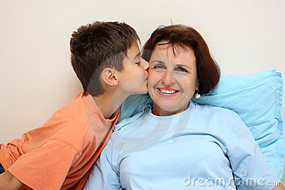 A boy kissing her grandmother