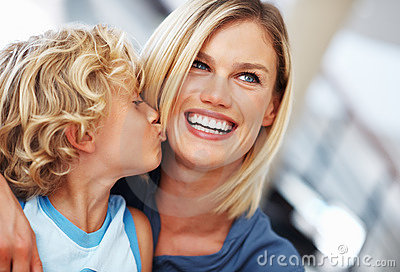 Boy kissing mother