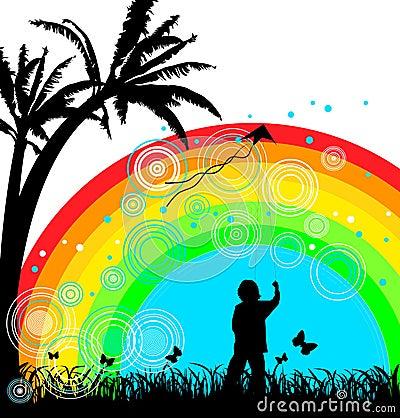 Boy with kite under rainbow