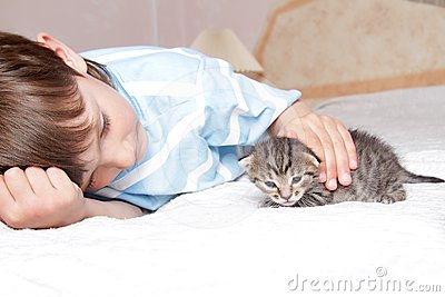 Boy with kitten at home