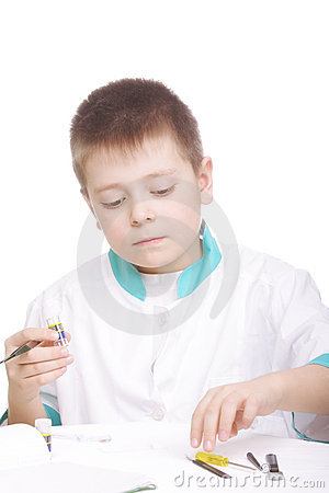 Boy and lab tools on desk