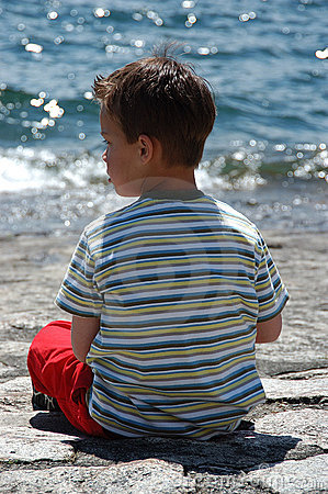 Boy at lake side