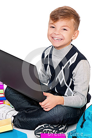 Boy with laptop and books