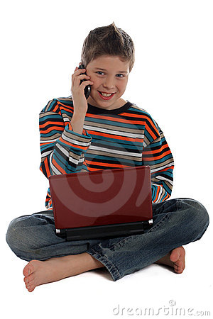 Boy with a laptop using the phone