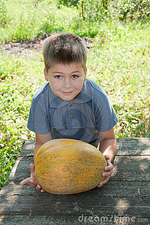 A boy with a large melon