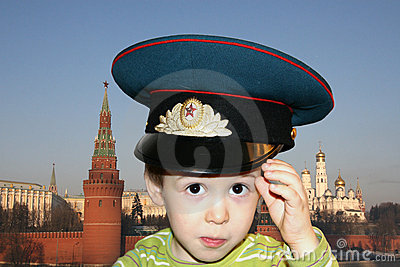 Boy with large Soviet cap