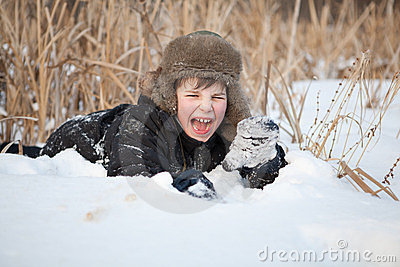 Boy lay on snow and cries, winter