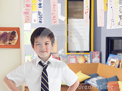 Boy Learning To Read From Hanging Paper Strip In Class
