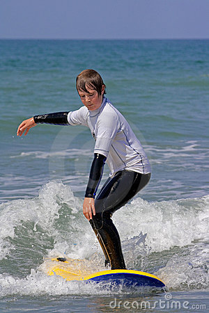 Boy learning to surf 1
