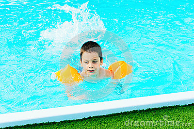 Boy learning to swim stock photo image 51647239 for What causes ear infections from swimming pools