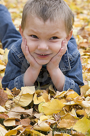 Boy in leaves close up