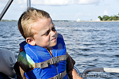 Boy in Life Vest Boating