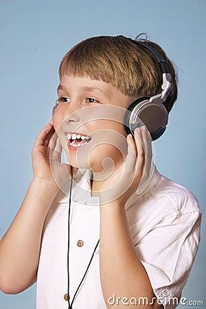 Free Boy Listening Music Stock Image - 215731