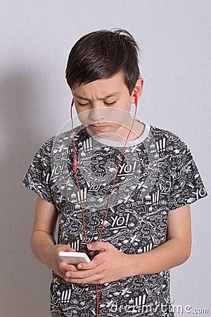 Free Boy Listening To Music Stock Image - 100341761