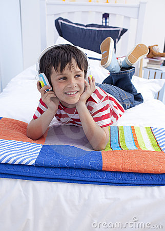 Boy listening to music with headphones on