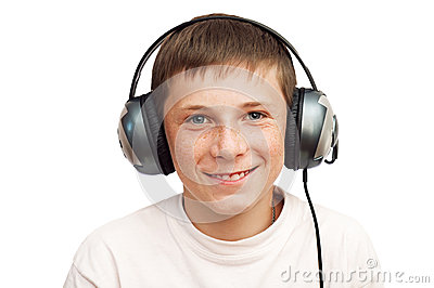 Boy is listening to music on headphones