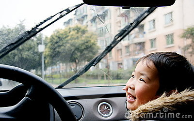Boy Looking At Auto Rain-brush Stock Photography - Image: 8507402