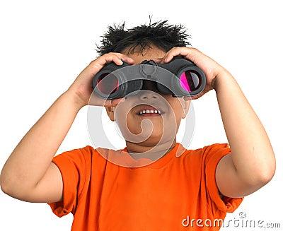 Boy looking through a binocular