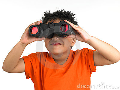 Boy looking through a binocular