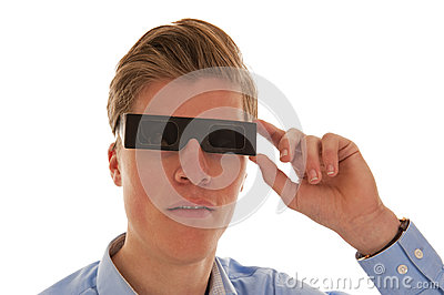 Boy looking through eclipse glasses