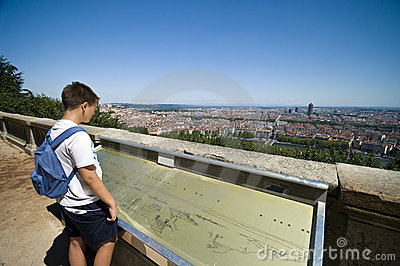 Boy looking at Lyon city