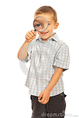 Boy looking through magnifier