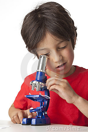 Boy looking through microscope