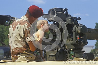 Boy Looking at Military Gun Editorial Image