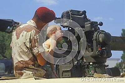 Boy Looking at Military Gun Editorial Image
