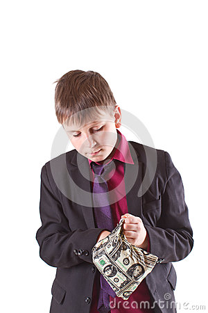Boy looking for money in the bag