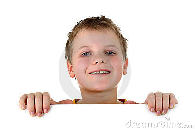 Boy looking out of whiteboard smiling isolated