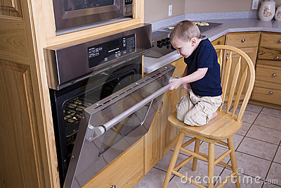 Boy looking in oven