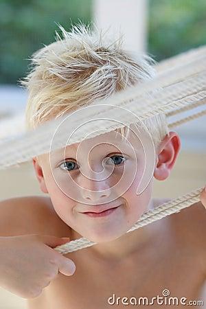 Boy Looking Between Ropes
