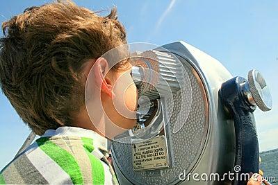 Boy looking through telescope