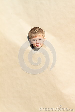 Boy looking thru hole