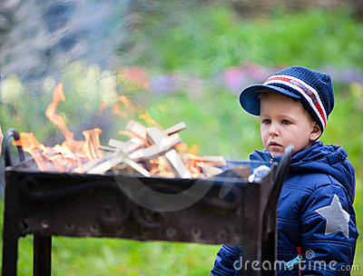 Boy looking to fire