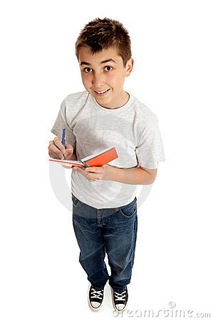 Boy looking up from a book and smiling
