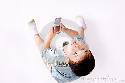 Boy looking upward with cell phone