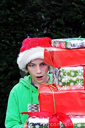 Boy looking at xmas presents