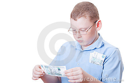 The boy looks at the bill