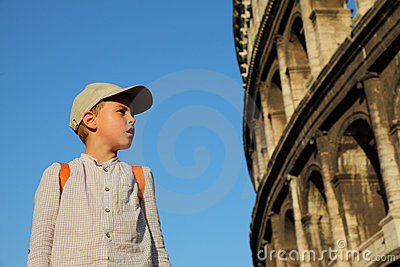 Boy looks at walls of the Coliseum