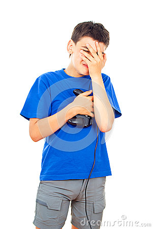 Boy lost in a video game with a joystick